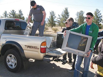 Courtesy<BR> Pictured from left are MCC Computer Club members Buddy Burrows-Taras, Frankie Devere, Tim Gardner and Shaun Douglass unloading a truck at the March event.