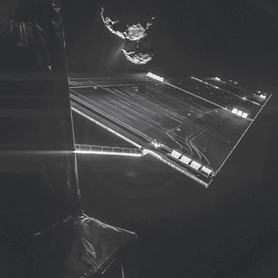 "EUROPEAN SPACE AGENCY/Courtesy<br>The Philae lander of the European Space Agency's Rosetta mission took this self-portrait of the spacecraft on Oct. 7 at a distance of 10 miles from comet 67P/Churyumov–Gerasimenko.  The image, taken with Philae's CIVA camera, captures the side of the Rosetta spacecraft and one of Rosetta's 46-foot-long solar wings, with the comet in the background. Two images with different exposure times were combined to bring out the faint details in this very high contrast situation. The comet's active ""neck"" region is clearly visible, with streams of dust and gas extending away from the surface."