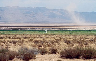 JC AMERBLYN/Miner<BR> A dust devil swirls over recently tilled soil north of Kingman in July. Kingman Farms' activity in the area as well as in Golden Valley sparked dust complaints that the Arizona Department of Environmental Quality responded to last week.