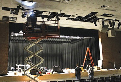 Workers continue upgrading the Lee Williams High School auditorium Tuesday. Because of a significant grant, the school's theater facilities will be greatly enhanced. (JC AMBERLYN/Miner)