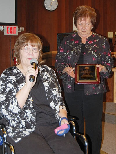 Former state Rep. Doris Goodale, R-Kingman, addresses well-wishers who attended a reception in her honor at Tuesday's City Council meeting as Mayor Janet Watson holds a plaque commemorating her years of service to the community. (DOUG McMURDO/Miner)