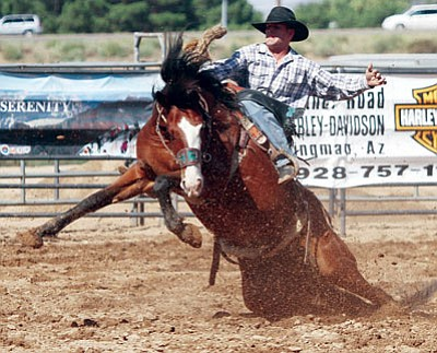 JC AMBERLYN/Miner<BR> Bronco rider Landon Mecham of Tropic, Utah, hangs on during September's 30th Annual Andy Devine Days Rodeo on the Mohave County Fairgrounds. The group managing the fairgrounds have put together a to-do list of upgrades, with some work scheduled to begin soon, but red ink remains a worry.