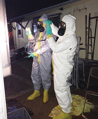 Members of a hazardous materials team inspect a methamphetamine lab in Golden Valley. (Courtesy)