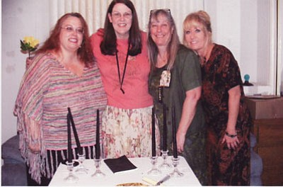 Xi Beta Phi: Pictured from left are Parliamentarian Renee Fields; new pledge, Lori Hoover; President Yvette Stratton; and Joyce Onnen, vice-president. The November meeting was at the home of Colleen Faucher. The guest was Cathy Lantz, wife of our late Beta Sigma Phi Envoy, Jim Lantz. All committees were discussed. This year's service project concentrates on the Kingman High School Displaced Students. Sisters have donated hundreds of dollars to that fund. A Pledge Ritual was conducted for our new sister, Lori Hoover. Joyce conducted the ritual with all sisters in attendance. Any questions, contact Pat Mullen at (928) 681-6385. (Courtesy)