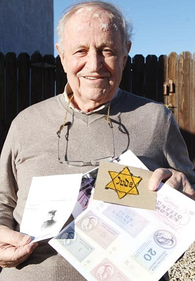 JC AMBERLYN/Miner<BR> Kurt Goldschmidt holds photos and memorabilia of some of the things he witnessed as a Holocaust survivor.