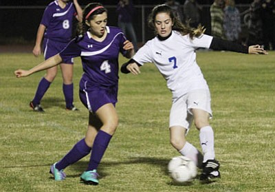 Kingman's Heather Simmons battles Lake Havasu's Emily Cunning for control of the ball last Thursday at KHS. The Lady Bulldogs defeated Havasu 1-0 Saturday for the Lake Havasu Soccer Tournament championship. (JC AMBERLYN/Miner)