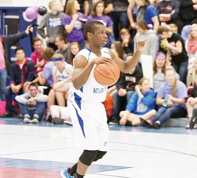 Henry Chinyere brings the ball up for Kingman Academy Dec. 10 against Lee Williams. Chinyere filled up the stats sheet in Tuesday's win over Seligman with 14 points, seven rebounds, four assists, one turnover and five steals. (RYAN ABELLA/Miner)