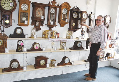 "JC AMBERLYN/Miner<BR> Willis L. Lynes, ""The Clock Man,"" stands by several clocks in his store at 226 E. Beale Street in 2007."