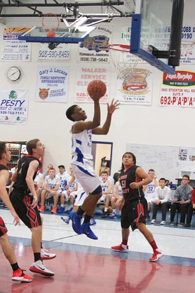 Academy's Jeffry Chinyere goes up for an easy bucket against River Valley Dec. 2 at KAHS. Chinyere led the Tigers with 17 points Friday at San Pasqual. (RYAN ABELLA/Miner)