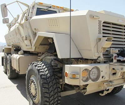 The Mohave County Sheriff's Office will return a Mine Resistant Ambush Protected military vehicle similar to this one owned by the Kingman Police Department. The sheriff's office obtained the MRAP from the Department of Defense's 1033 program earlier this year. (DOUG McMURDO/Miner)