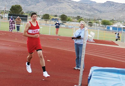 Lee Williams' Giancarlo Narvarte approaches the bar during the high jump at Kingman High. Narvarte won the Division III state championship in the event with a a leap of 6 feet, 6 inches, which has given him the honor of being the No. 1 sports story in Kingman for 2014. (SHAWN BYRNE/Miner)