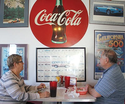 Mary and David Nickel check out the diner's Route 66 and classic car memorabilia.