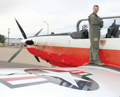 JC AMBERLYN/Miner<BR>Lieutenant Commander David Flowers is pictured Friday with his T-6B Texan 2 plane.