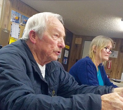 HUBBLE RAY SMITH/Miner<BR> Charles Cox, left, runs the Mohave County Fair Association board of directors meeting Thursday. He was elected to a second term as chairman of the board. Administrative assistant Colletta Comer sits to his left.