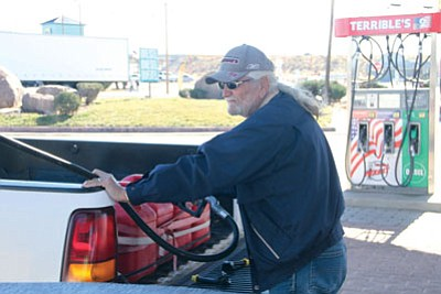 "JC AMBERLYN/Miner<BR> Lyle Swangle was at Terrible's on Andy Devine Avenue Thursday filling up several gas containers to supply the gas needs of various pieces of ranch equipment that he owns. He was in town to buy a number of things. He commented, ""It sure makes it easier buying hay, because gas is so cheap."""