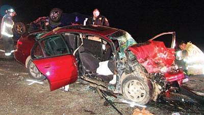 Courtesy<BR> Golden Valley and Kingman firefighter-paramedics teamed up to rescue three adults and a child involved in a head-on collision Saturday night on U.S. 93. The driver of the other car, a Chevrolet sedan, might have been driving the wrong way on the highway.