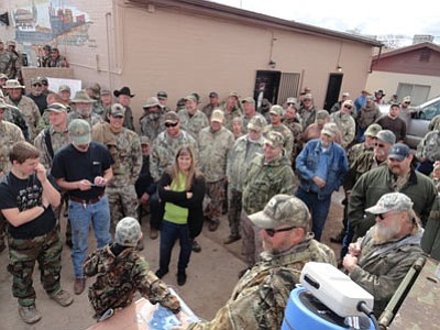 Hunters gather in Seligman for last year's coyote hunt.