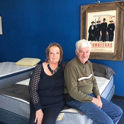 Lynda and Jerry Boyd sit on a Serta mattress at their store, Boyd's Outlaw Sleep Centers, at 3930 Stockton Hill Road, where they've been for 10 years. The store is moving to 3124 Stockton Hill Road, next to Sears in the Frontier Plaza, with an opening date of April 1. (HUBBLE RAY SMITH/Miner)