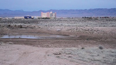 This vacant land owned by the city could be home to Kingman Crossing, the city's next Interstate 40 interchange and home to a multitude of potential shopping and dining outlets – if the Council approves a major amendment to the general plan that would change the designation from open space and parks to regional commercial. Voters would have to approve the city selling the land. This photo was taken just off Sage Street with Hualapai Mountain Medical Center pictured on the other side of the interstate. (JC AMBERLYN/Miner)