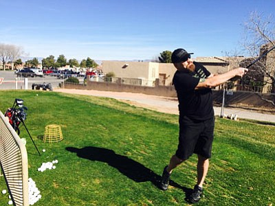 James Berry practices his iron shots Thursday at Cerbat Cliffs Golf Course. He said the weather was perfect for wearing shorts and a T-shirt. Thursday's high temperature in Kingman was 76 degrees, according to AccuWeather.