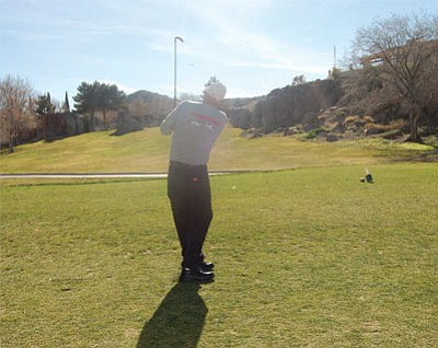 Kingman resident Rick Stevenson hits a tee shot at Cerbat Cliffs Golf Course on a beautiful February day. The city has made changes to the course that has resulted in a substantial reduction in water use. (DOUG McMURDO/Miner)