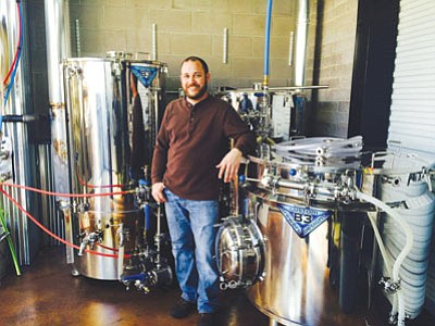 Tim Schritter, owner of Black Bridge Brewery in Kingman, shows new equipment that he recently purchased for his business. He said proposed legislation that didn't advance Monday could put him out of business. (HUBBLE RAY SMITH/Miner)