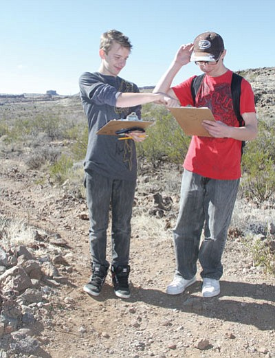 Damian Cooke, 12, and Broc Deherrera, 13, look at some of their data at the trailhead. (JC AMBERLYN/Miner)