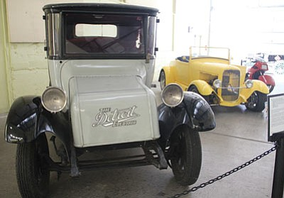 A Detroit Electric Model 60 is among the electric vehicles on display. The line was manufactured from 1907 to 1938. This is a 1930 model. (JC AMBERLYN/Miner)