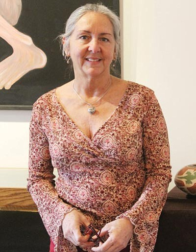 Courtesy<BR> Angela Patterson, owner of Beale Street Brews, stands inside the art gallery Tuesday at her coffee shop.