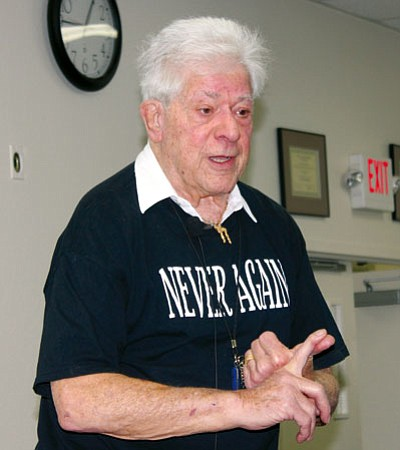 LIBBY HANKS/MCC<BR> Holocaust survivor Stephen Nasser speaks to a packed room at Mohave Community College Wednesday.