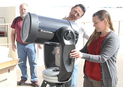 From left to right, Chris Patrick of High Desert Astronomy, and Chris Atkinson and Sharka White of Kingman Unified School District, set up the new Celestron 11-inch telescope. (JC AMBERLYN/Miner)