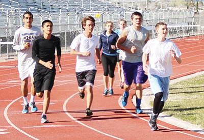 Kingman High boys and girls track teams open the season at 3:30 p.m. today in Lake Havasu City. The Bulldogs are looking to rebuild their program this season. (SHAWN BYRNE/Miner)