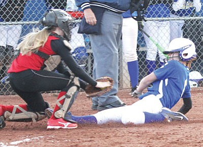 Kingman's Ally Applegate is thrown out at home trying to tag up in the fifth inning of the Lady Bulldogs' loss to River Valley Tuesday at KHS, 10-1. Applegate had tripled down the right-field line to get into scoring position. (JC AMBERLYN/Miner)