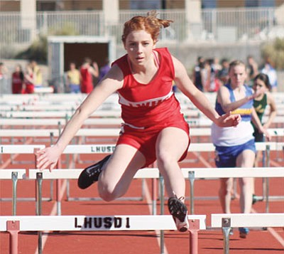 Lee Williams High's Noelle Araujo is on her way to a fifth-place finish in the 100-meter hurdles Wednesday in a track meet at Lake Havasu City. (KEVIN BAIRD/Today's News-Herald)
