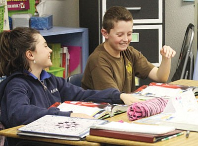 Breanne Vogt and Connor Watson in Debbie Stephens' fifth-grade class at Kingman Academy of Learning Intermediate School Thursday.