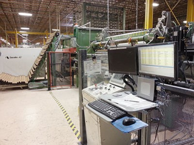 Courtesy<BR> A computer terminal is shown next to one of Cascades Tissue Group's manufacturing machines. The terminals are connected to a server in Canada and relay information including quality metrics and how much product is getting pushed through. That information requires a constant Internet connection.