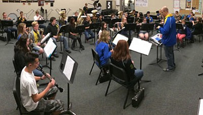 The Kingman High School Wind Ensemble practicing in the band room at KHS, with Michael Schreiber directing. (RYAN ABELLA/Miner)