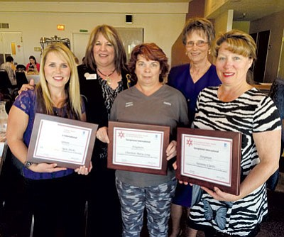 RYAN ABELLA/Miner<BR>The Ruby Award winners. Pictured from left is Jamie Hicks, Pam Plew from Soroptimist, Charleen Long, Linda Miller from Soroptimist, and Dora Manley. Manley accepted the award on behalf of Suzanne Clarke.