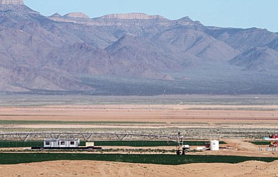 JC AMBERLYN/Miner<BR>Center pivot irrigation systems such as this one north of Kingman, and the wells they need to function, are a source of concern for residents worried about the future water supply for the area.
