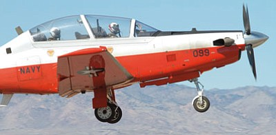RYAN ABELLA/Miner<BR> The pilot of this T-6B Texan II trainer aircraft is taking part in touch-and-go maneuvers on the Kingman Airport runway on Feb. 25. The U.S. Navy pilots have been training since early January and will wrap up their time here this week.
