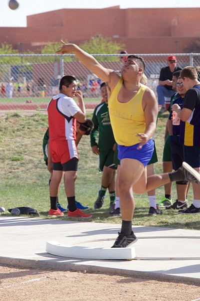 Kingman High's Abraham Ruelas shows winning form during the shot put Wednesday in the Kingman Multi.  Ruelas won the event with a throw of 44 feet, 9 inches. (RYAN ABELLA/Miner)
