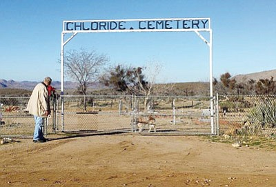 Courtesy<BR> John Thompson, vice president of the Chloride Cemetery Association, opens the gate to the historic cemetery with burials dating back to 1904. Mohave County Public Works recently completed work on realigning Patterson Road to access the cemetery.