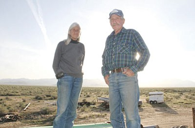 Char and Johnny Sangick stand on their property near Valle Vista Friday in the Haulapai Valley overlooking Kingman Farms and Red Lake. (JC AMBERLYN/Miner)