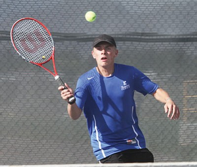 Kingman's Kaegan Rivedal returns a shot during the Bulldogs' 9-0 loss to Bradshaw Mountain (4-6 Division II, 1-1 Section III) Tuesday at KHS. Kingman (0-7, 0-1) is looking for its first win of the season at Prescott (10-0, 1-0) today. (JC AMBERLYN/Miner)