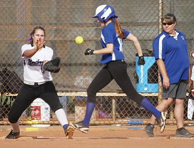 JC AMBERLYN/Miner<BR> Kingman Academy's Abbie Boss tries to beat out a grounder to shortstop before Northwest Christian's first baseman Jordan Rodenkirk catches the throw during the fourth inning of Northwest's 5-4 win over the Lady Tigers Friday at Centennial Park. Boss was out on the play, but she did single in the sixth. Academy hosts No. 5-ranked River Valley at 6 p.m. Tuesday at Centennial Park Field 7.
