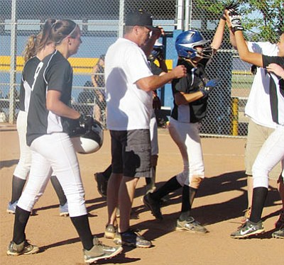 Kingman's Avery Lee is greeted by her team after knocking in the tying and winning runs during the Lady Bulldogs' win over Wickenburg Monday at KHS, 6-5. Lee also doubled earlier in the game that drove in another run for Kingman. (JODI LEE/Courtesy)
