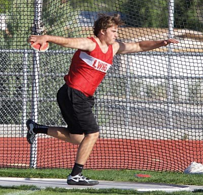 Kaleb Smith of Lee Williams is mid-spin during an attempt in the discus throw at the Colorado River Region Championships Wednesday at Lee Williams High. (RYAN ABELLA/Miner)