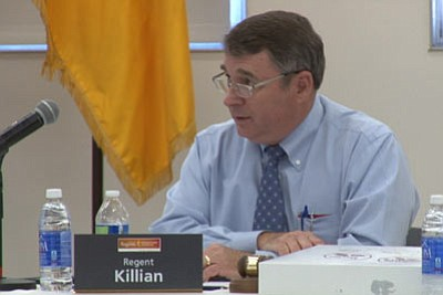 Mark Killian, chairman of the Arizona Board of Regents, participates in a hearing Monday night on university plans for raising student tuition and fees. (Cronkite News)