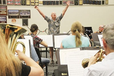 Art Swanson, conductor of the Mohave Community Orchestra, leads his group in rehearsal. (JC AMBERLYN/Miner)