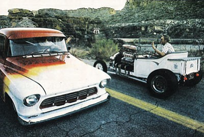 Bob Patterson, right, riding in a modified 1928 Model T, exchanges greetings with Kayelynn Johnson in a 1955 Chevy truck on Route 66 west of Kingman. The photo ran in a special supplement to the Miner in 1990. (BOB SMITH/Miner)